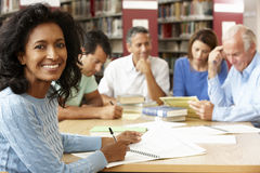 Mature students working in library Royalty Free Stock Photography