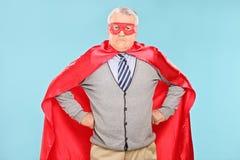 Mature superhero on blue background Royalty Free Stock Images