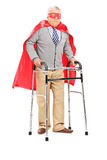 Mature superhero walking with walker Stock Photography