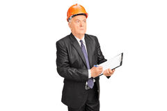 Mature supervisor holding a clipboard. Isolated on white background Stock Photos