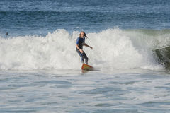 Mature surfer rides shore break California Royalty Free Stock Photos