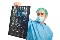 Mature surgeon man review magnetic resonance. Mature surgeon man with protective mask review magnetic resonance imaging isolated on white background royalty free stock images