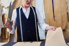 Mature Tailor Making Clothes in Atelier Studio Royalty Free Stock Photos