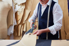 Mature Tailor Making Garments in Atelier Studio Stock Images