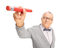 Mature teacher erasing something with eraser Royalty Free Stock Image