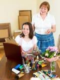 Mature teacher gives advice pupil Stock Photo