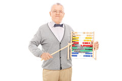 Mature teacher pointing with a stick on an abacus Stock Image