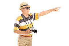 Mature tourist pointing at something with hand. Isolated on white background Stock Photos