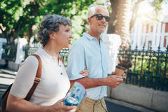Mature tourist roaming in a town Stock Photo