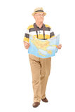 Mature tourist walking with map in his hands Royalty Free Stock Photo