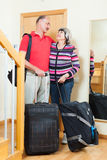 Mature  tourists with luggage Stock Photography