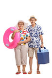 Mature tourists with a swimming ring and a cooling box. Full length portrait of mature tourists with a swimming ring and a cooling box isolated on white stock image