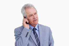 Mature tradesman talking on his cellphone. Close up of mature tradesman talking on his cellphone against a white background Stock Photos