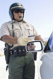 Mature Traffic Cop Holding License Royalty Free Stock Photography