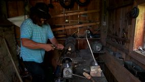 Mature turner working at lathe workshop. stock footage