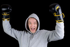 Mature victorious man with boxing gloves Stock Images