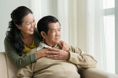 Mature Vietnamese couple at home Royalty Free Stock Photo