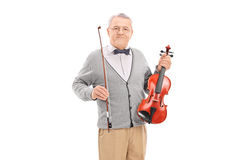 Mature violinist posing with his violin Royalty Free Stock Photography