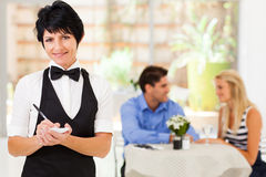 Mature waitress working Royalty Free Stock Photography
