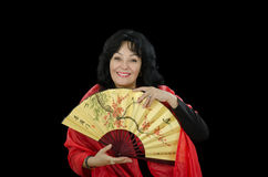 Mature white actress with Japanese fan Stock Photography