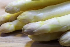 Mature white asparagus tips for sale from greengrocers in spring Stock Image