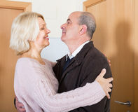 Mature wife meeting husband near door Royalty Free Stock Image