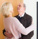Mature wife meeting husband near door Royalty Free Stock Photo