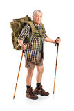 Mature With Backpack Holding Hiking Poles Stock Image