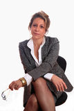 Mature woman. Senior business woman sitting on a chair Royalty Free Stock Photography