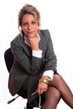 Mature woman. Senior business woman (fifties) sitting on a chair Royalty Free Stock Image