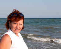 Mature woman. Mature woman enjoying her vacation at the beach Royalty Free Stock Photo