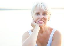 Mature woman. Portrait of positivity senior woman outdoor stock image