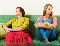 Mature woman and adult daughter having conflict Stock Image