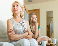 Mature woman and  adult daughter having quarrel Stock Photography
