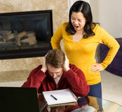 Mature woman angry at her man while working from home Royalty Free Stock Image