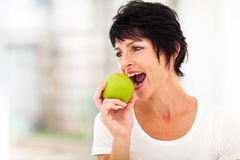 Mature woman apple Royalty Free Stock Images