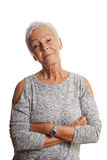 Mature woman with arms folded and head tilted Stock Photos