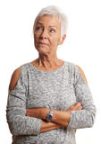 Mature woman with arms folded looking away Royalty Free Stock Photo