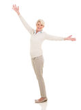 Mature woman with arms open Stock Photo