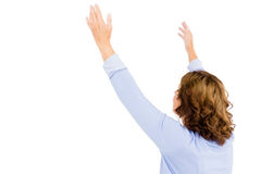 Mature woman with arms raised while praying. Against white background royalty free stock photography