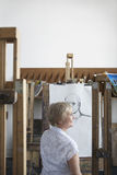 Mature Woman In Art Studio Royalty Free Stock Photography