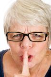 Mature woman asking for quiet Royalty Free Stock Photography