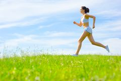 Mature Woman Athlete. Practicing in a spring meadow, from a complete series Stock Photo