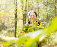 Mature woman in autumn Royalty Free Stock Photos