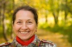 Mature woman  in autumn park. Portrait of mature woman  in autumn park Stock Images