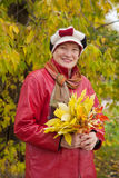 Mature woman  in autumn park Royalty Free Stock Photo