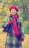 Mature woman in autumn park Stock Images