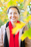 Mature woman  in autumn park Royalty Free Stock Images