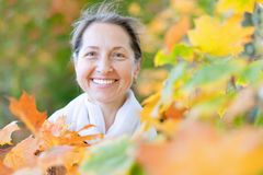Mature woman  in autumn park Royalty Free Stock Photography