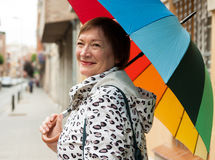 Mature woman  at autumn street Stock Photos